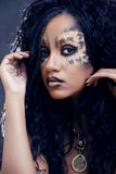 Beauty afro girl with cat make up, creative leopard print closeup halloween woman. Beauty afro girl with cat make up, creative leopard print on face closeup Stock Image