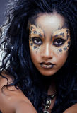 Beauty afro girl with cat make up, creative leopard print closeup halloween woman Royalty Free Stock Photo