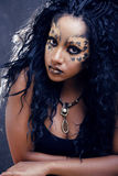 Beauty afro girl with cat make up, creative leopard print closeup halloween woman Royalty Free Stock Image