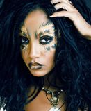 Beauty afro girl with cat make up, creative leopard print closeu. Beauty afro girl with cat make up, creative leopard print on face closeup halloween woman stock photos