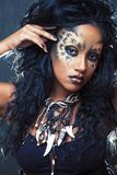 Beauty afro girl with cat make up, creative leopard print closeup, fashion style halloween look stock photo