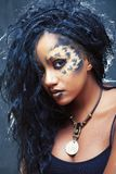 Beauty afro girl with cat make up, creative leopard print closeup, fashion style halloween look stock photography