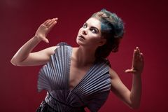 Beauty alien woman in futuristic dress Stock Photos