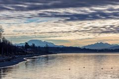 Free Beauty And Beast.  Freight Train Rumbles Between Seafront And Mountains. Royalty Free Stock Photos - 107208568