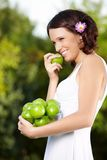 Beauty with an apple Stock Photo