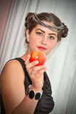 Beauty and apple. Young beautyful girl is offering an apple Royalty Free Stock Photography