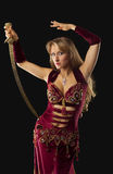 Beauty arabian dancer stand with saber on hip Stock Photo