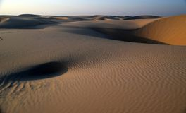 The Beauty of the Arabian Desert and Ripples Caused by its Warm Winds Royalty Free Stock Photography