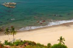 Beauty Arambol beach in India, Goa. Sand tropical beach with coconut trees and traditional boat - Arambol beach, Goa, India Royalty Free Stock Photography