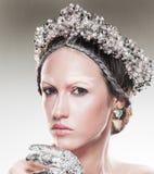 Beauty art portrait of young woman wearing jewelry Stock Photo
