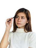 Beauty Asian Girl holding a black Pencil . Royalty Free Stock Photo