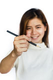 Beauty Asian Girl holding a black Pencil . Royalty Free Stock Photos