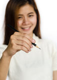 Beauty Asian Girl holding a black Pencil . Stock Photos