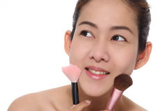 Beauty asian girl make up her face. Look to good healthy Royalty Free Stock Photo