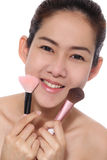 Beauty asian girl make up her face. Look to good healthy Royalty Free Stock Images