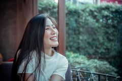 Beauty asian girl`s smiling and looing at happy emotion day royalty free stock images