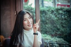 Beauty asian girl`s smiling and looing at happy emotion day stock image