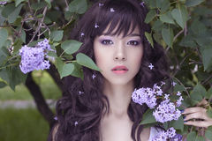 Free Beauty Asian Girl With Lilac Flowers Stock Photos - 97234243