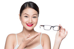 Beauty asian model girl with perfect skin showing glasses, isola. Beauty asian model girl with perfect skin showing glasses,  on white background Royalty Free Stock Photo