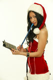 Christmas Woman. beauty asian model girl in santa costume Stock Photo