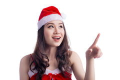 Beauty Asian Model Girl in Santa Hat Looking up and Pointing iso Royalty Free Stock Photo