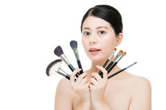 Beauty asian portrait smiling woman brunette holding brushes for Royalty Free Stock Photo