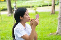 Beauty asian Student Makeup Lips in park. Beauty asian Student Makeup Lips in green park Stock Photography