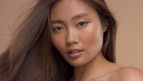 Thai Asian model with natural makeup on beige background stock video footage