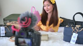 Beauty Asian Vlogger blogger interview with professional DSLR digital camera film video live. Woman coaching trading and review