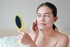 Beauty asian woman applying makeup with Sponge Powder Puff. stock photo