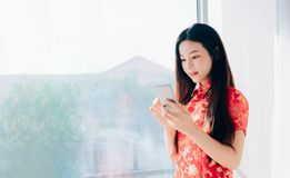 Beauty Asian Woman with Chinese dress,Qipao,Cheongsam Chinese New Yea