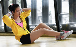 Beauty asian woman doing sit ups practice royalty free stock images