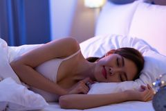 Woman sleep well on bed. Beauty asian woman has a good sleep on the bed at night stock photography