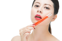 Beauty asian woman red lips nail and holding chemistry tube. Beauty asian woman red lips nail and holding lab tube with red chemistry liquid, isolated on white Stock Photography