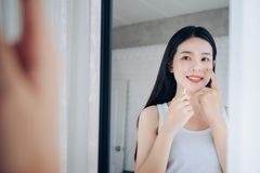 Beauty Asian Woman use Acne Gel Skincare after Cleansing royalty free stock images