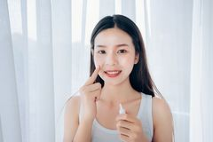 Beauty Asian Woman use Acne Gel Skincare after Cleansing stock photo