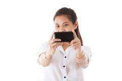Beauty Asian woman using Smart phone. Beauty Asian woman using smartphone take picture herself isolated on white background focusing shot Stock Photo