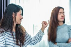 Beauty Asian woman was reconciled by girlfriend after argument in bedroom background. Depressed and bright tone feeling. People. Beauty Asian women was stock photography