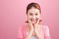 Beauty Asian Young Portrait. Beautiful Spa Woman Touching her Fa Stock Photography