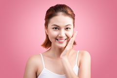Beauty Asian Young Portrait. Beautiful Spa Woman Touching her Fa Royalty Free Stock Photography