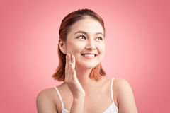 Beauty Asian Young Portrait. Beautiful Spa Woman Touching her Fa Royalty Free Stock Image