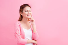 Beauty Asian Young Portrait. Beautiful Thinking Woman Touching h Royalty Free Stock Photos