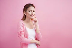 Beauty Asian Young Portrait. Beautiful Thinking Woman Touching h. Er Face Royalty Free Stock Photo