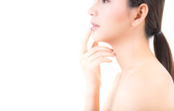 Beauty asian young woman with clean fresh skin touch lips. Stock Photography