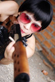 Beauty assasin. Asian girl roll play be the assassin Stock Photography