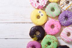 Beauty assorted donuts. Assorted donuts with chocolate frosted, pink glazed and sprinkles . Top view stock images