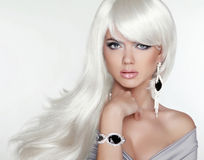 Beauty attractive blond portrait. White Long hair. Fashion girl. Model posing with Expensive Jewelry Stock Images