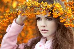 Beauty autumn portrait of attractive girl over yellow brunch of Royalty Free Stock Photo
