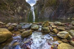 Beauty autumn view on a waterfall. long exposure. Waterfall `jump` near the village Kaleytsa near Troyan and several zen stone Royalty Free Stock Image