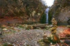 Beauty autumn on a waterfall. Beauty autumn view on a waterfall `jump` near the village Kaleytsa near Troyan and several zen stone Stock Photography